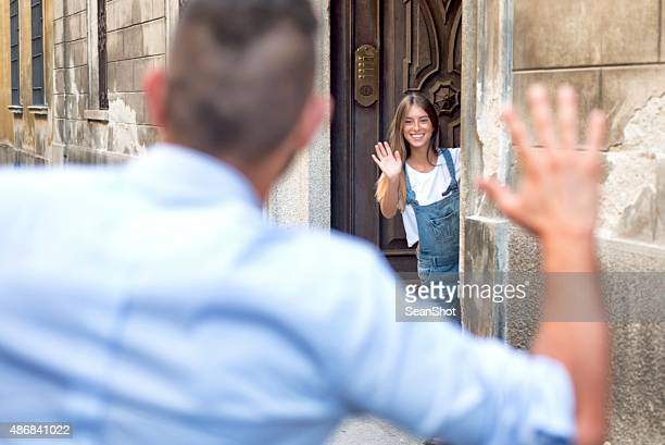 Young woman waiting her boyfriend on doorstep