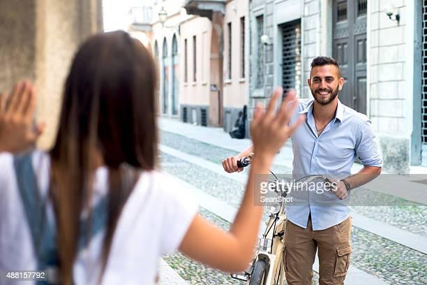 Young woman waiting her boyfriend on doorstep