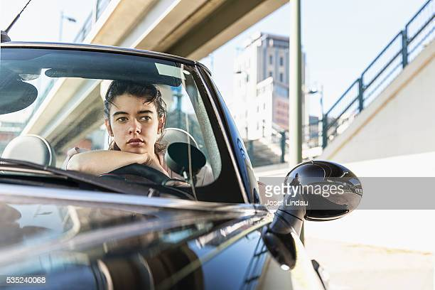 Young woman waiting in car