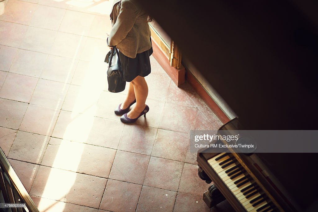 Young woman waiting in hotel lobby : Stock Photo