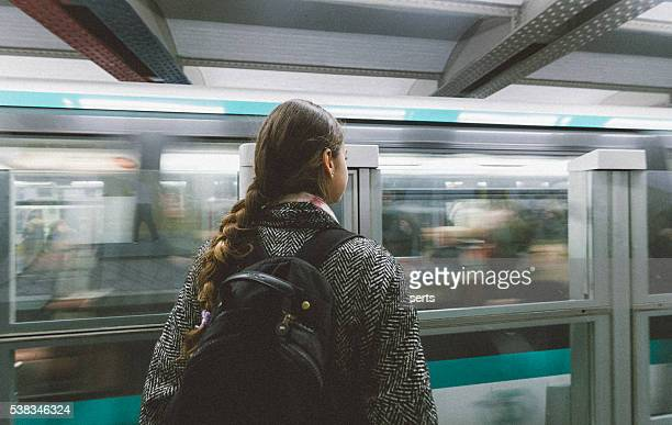 Young woman waiting the train in paris subway station