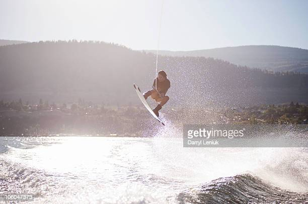 young woman wakeboarding