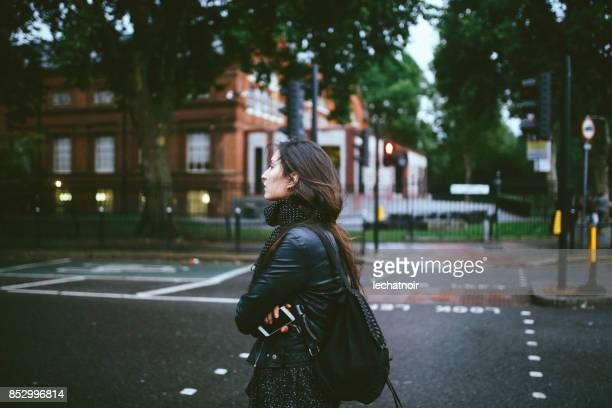 Young woman walking alone on the streets of London