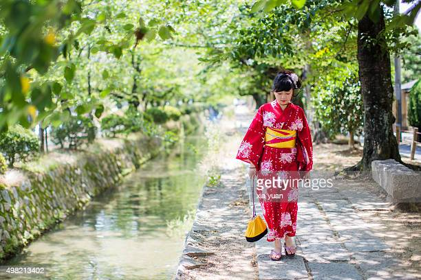 Young woman walking along the Tetsugaku-no-Michi (Path of Philosophy) with Kimono,Kyoto