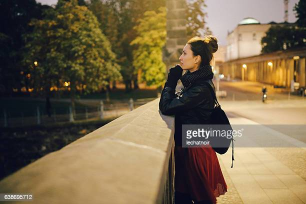 Young woman walking and relaxing in Berlin Mitte at night