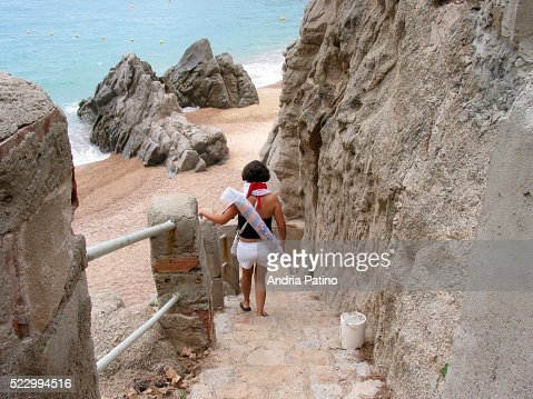 Young Woman Walking Down Stairs to Beach