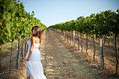 Young woman walking in a vineyard