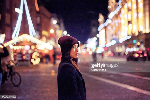 Young woman walking in Christmas Market