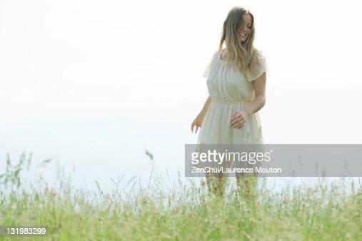woman walking in grass - photo #32