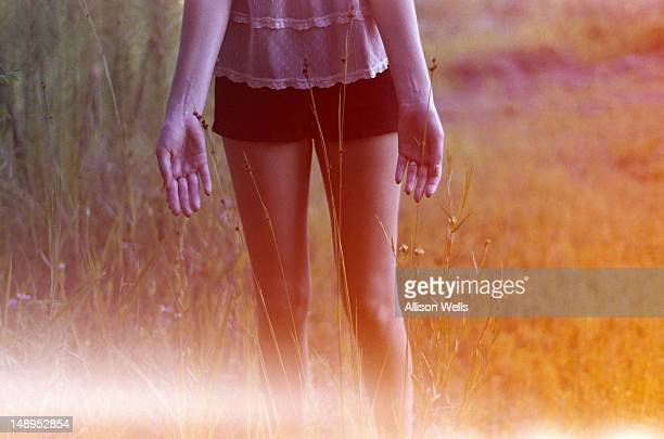 Young woman walking in grass