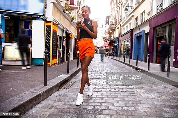 Young woman walking in Paris city streets