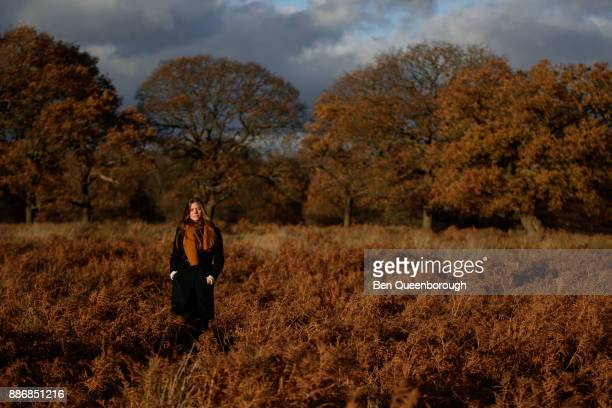 A young woman walking in the countryside
