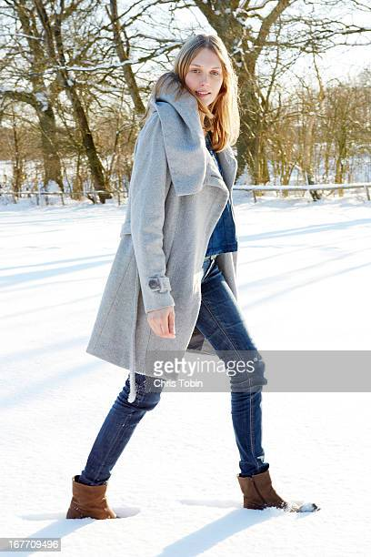 Young woman walking in the snow