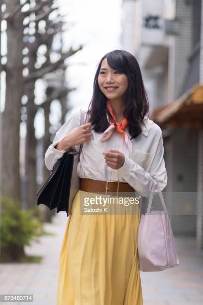 Young woman walking on shopping street
