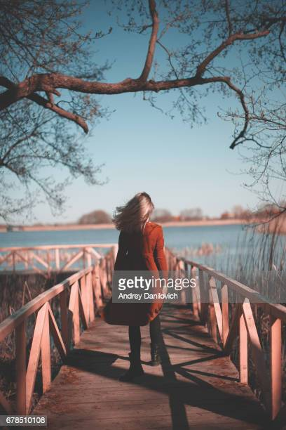Young woman walking on the bridge