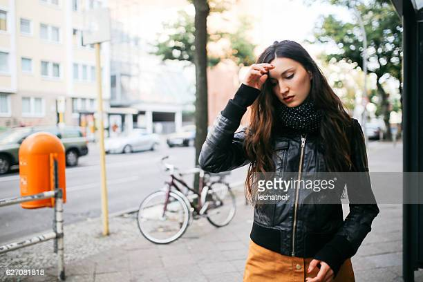 Young woman walking on the street in Berlin
