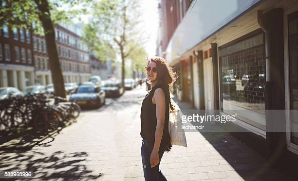 Young woman walking on the streets of Amsterdam