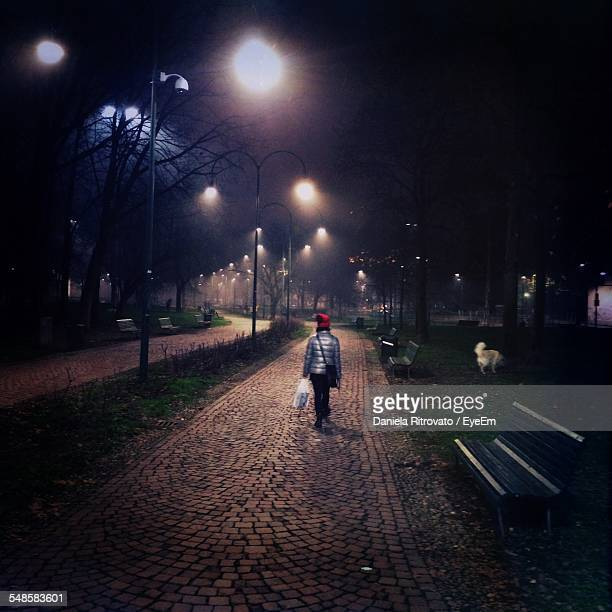 Young Woman Walking Out Her Dog At Night