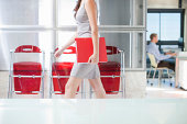 Young woman walking through office