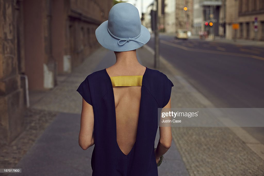 A young woman walking through the city : Stock Photo