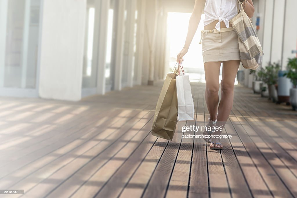 Young woman walking with shopping bags