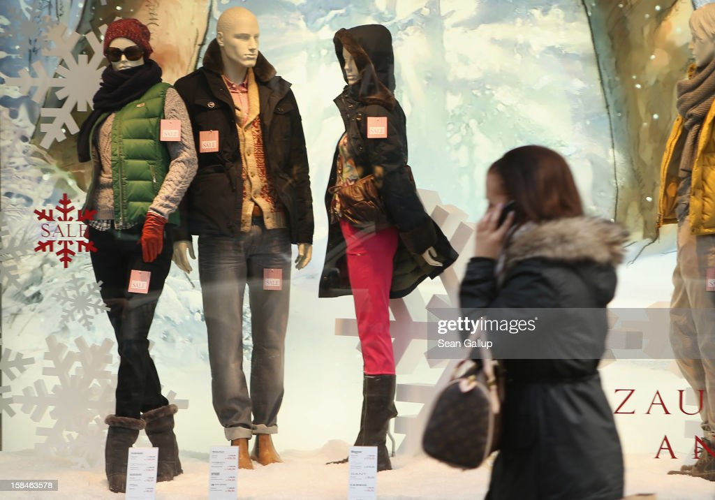 A young woman walks by a clothing store's winter display on a shopping street in Steglitz district on December 17, 2012 in Berlin, Germany. Retailers are hoping for a strong Christmas season in Germany, one of the few countries whose economy has so far weathered the current Eurozone debt crisis relatively well.