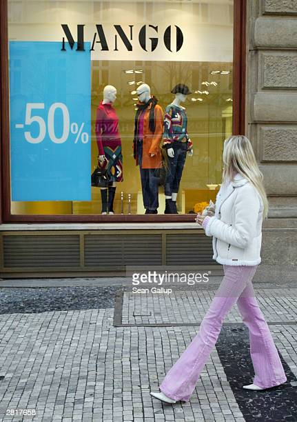 A young woman walks by a Mango clothing store offering preChristmas discounts December 17 2003 in Prague Czech Republic Retailers throughout Europe...
