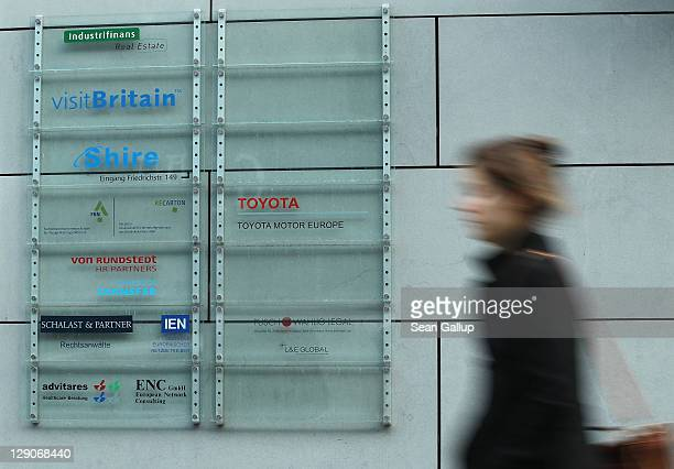 A young woman walks past an office building at Dorotheenstrasse 54 in Mitte district on October 12 2011 in Berlin Germany Mitte district is home not...