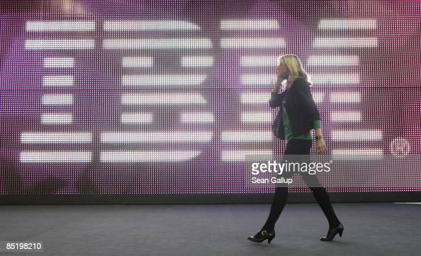 A young woman walks past the IBM logo at the 2009 CeBIT technology trade fair on March 3 2009 in Hanover Germany CeBIT the world's largest computer...