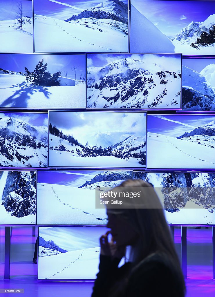 A young woman walks past UltraHD 4000K television on display at the Panasonic stand at the IFA 2013 consumer electronics trade fair on September 5, 2013 in Berlin, Germany. The 2013 IFA will be open to the public from September 6-11.