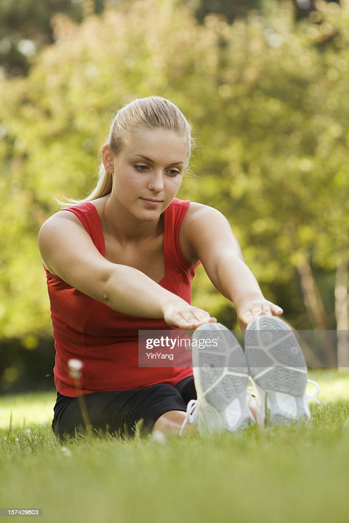 Young Woman Warming Up for Her Workout : Stock Photo