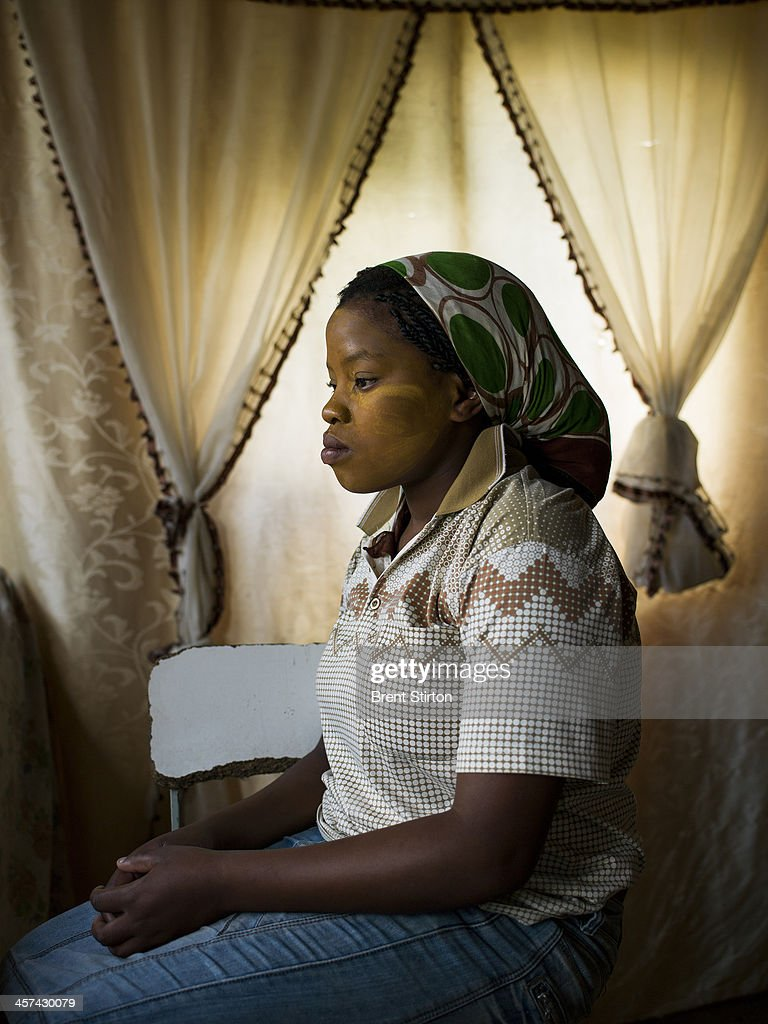 A young woman watches from her home as a crowd gathers on a hilltop for the Nelson Mandela funeral, Qunu, South Africa, 14 December 2014. An icon of democracy, Mandela was buried at his family home in Qunu after passing away on the 5th December 2013.
