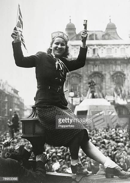 8th May 1945 A girl reveller in Piccadilly Circus London on VEDay with Union Jack and rattle