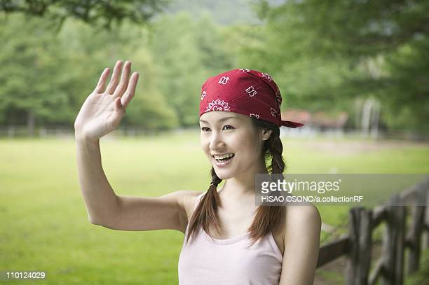 Young Woman Waving Hands