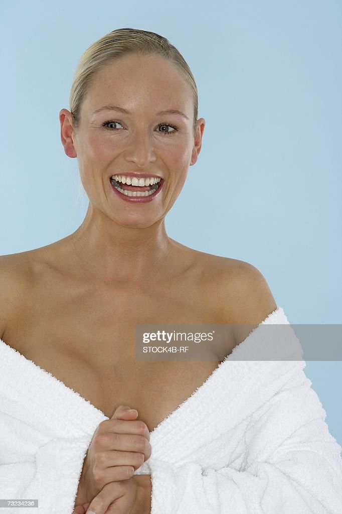 Young woman wearing a bathrobe : Stock Photo