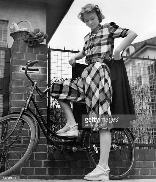 Young woman wearing a bloomers for cycling about 1940 Photographer Sonja Georgi Published in Erika 20/1940Vintage property of ullstein bild