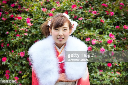 Young woman wearing a kimono and fur collar : Stock Photo