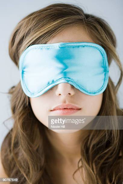young woman wearing a sleeping mask