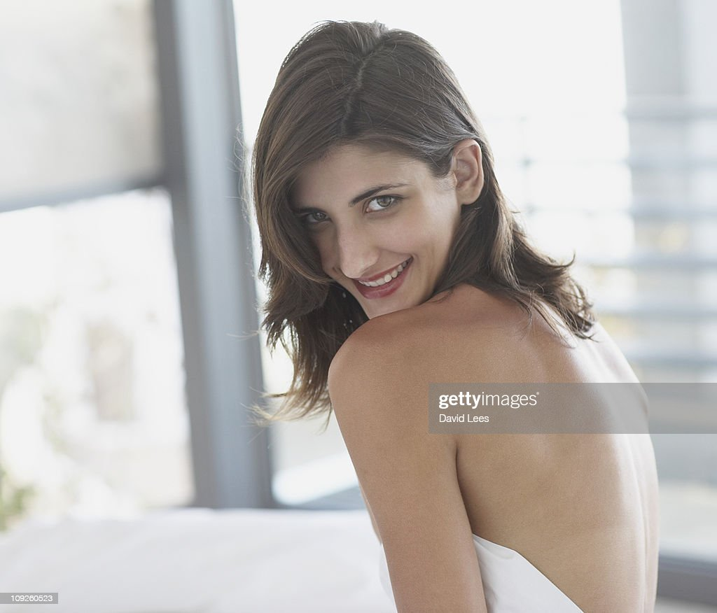 Young woman wearing a towel, smiling : Stock Photo
