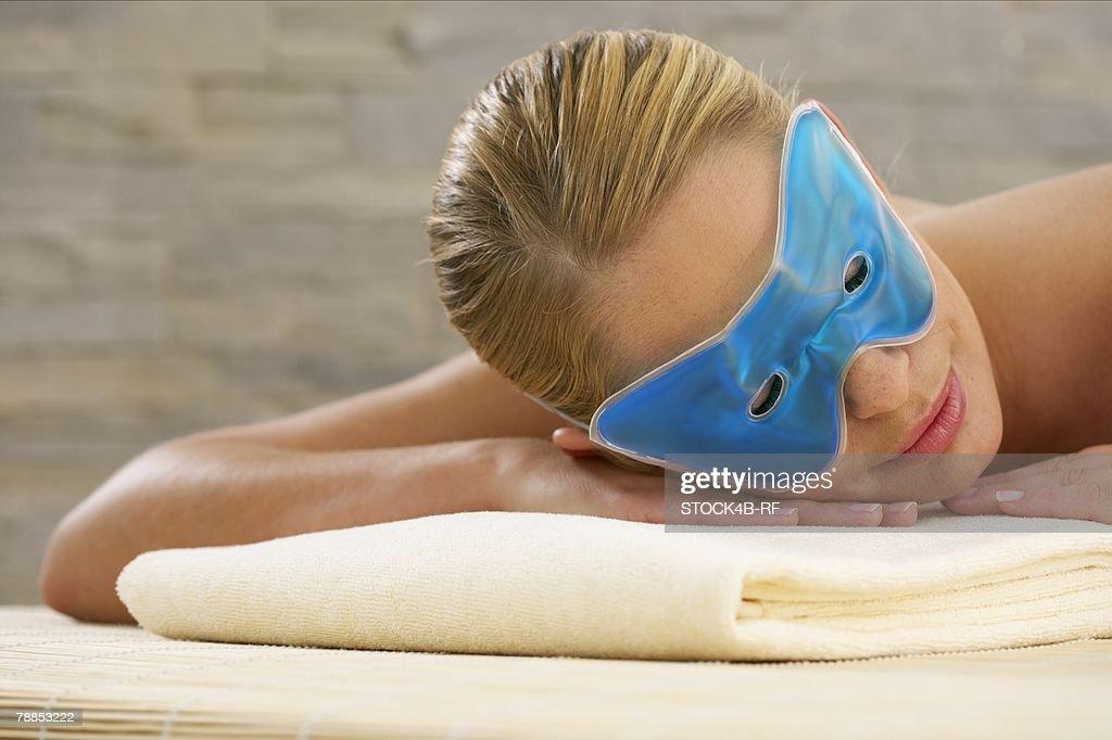 Young woman wearing an eye mask : Stock Photo