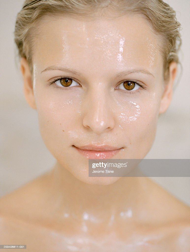 Young woman wearing beauty mask, portrait : Stock Photo