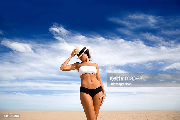 Young Woman Wearing Bikini and Standing on Beach