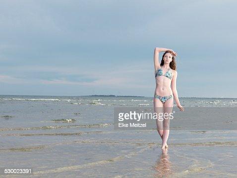Young woman wearing bikini in sea