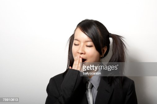 Young Woman Wearing Black Suit And Pigtails Yawning Stock ...
