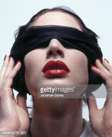 Young woman wearing blindfold, close-up : Photo