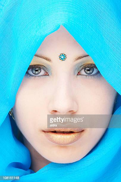Young Woman Wearing Blue Head Wrap and Dot on Forehead