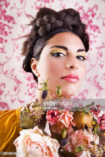 Young Woman Wearing Braided Bun Posing with Flower Bouquet