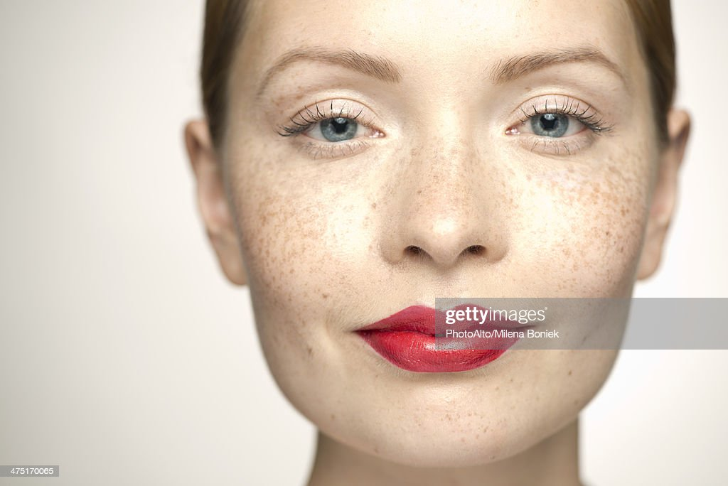Young woman wearing bright red lipstick, portrait : Stock Photo