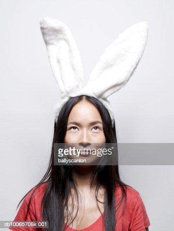 Young woman wearing bunny ears