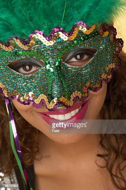 Young Woman Wearing Carnival Mask
